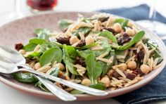 This spinach and whole wheat pasta salad, tossed with sun-dried tomatoes and garbanzo beans (also known as chickpeas), is satisfying enough as a light main course, or perfect to serve alongside grilled entrées.