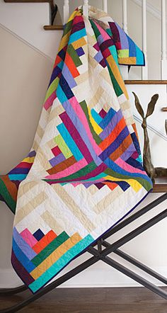 Summer 2015 edition of Fons & Porters Easy Quilts is an easy log cabin called 'Summer Cabin' by Anita Peluso, using vibrant solids from the American Made Brand solid fabric collection, available at http://www.yoderdepartmentstore.com/amb_solids.aspx