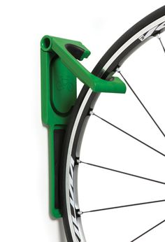 EndoFold flat vertical storage Attractive, vertical cycle storage, for home, office or retail applications. Ideal for high density installations with little space, secure four point fixing, fixings included. Protect your wheels and wall with wide rubber contact points, front & rear wheel pad included. Hollow hinge accommodates a conventional bicycle lock. Discrete fold flat facility, only 3.2cm thick when folded.