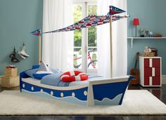 boat bed. Put whales on the walls. He would go crazy!