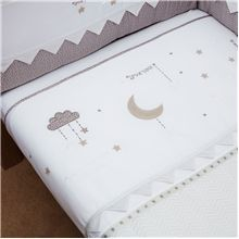 To The Moon and Back Coverlet from Silver Cross. This cosy coverlet offers the warmth of a blanket and flat sheet without the need for bulky bedding. Made from 100% cotton with a soft touch jersey lining, it's exquisitely decorated with textured hand finished accents and delicate embroidery for a premium feel.