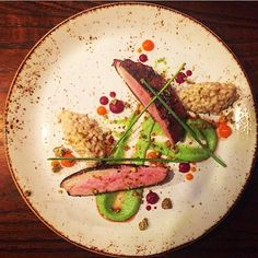Duck breast, barley, pea puree, pepper gel, jam made from beets.