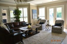We kept this family room kid friendly by keeping the leather sofa and adding new throw pillows, a shag rug, swivel chairs, art and a new accent table in the corner.  We kept the accessories on the coffee table minimal and unbreakable!