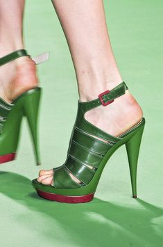Krizia Spring 2011   ***Darling leprechaun green pump with red accent...luv.  i see white v neck tee and dark wash skinny jeans or a matching green dress paired with these...yep!***
