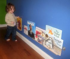 Eleanor's Ikea Hack Book Display Reader Project: use the RIBBA picture ledge with the BYGEL rail and make it even sturdier. Ikea Bygel, Ribba Picture Ledge, Book Rest, Book Racks, Kids Room Organization, 12th Book, Library Displays, Media Center, Storage Solutions