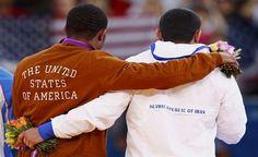 A photograph of wrestlers Jordan Burroughs and Sadegh Goudarzi at the 2012 Olympic Games in London.