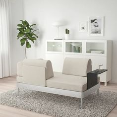 DELAKTIG 2-seat sofa with side table, Gunnared beige - IKEA