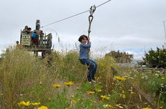 Riding the zip line at Adventure Playground by Derringdos, via Flickr