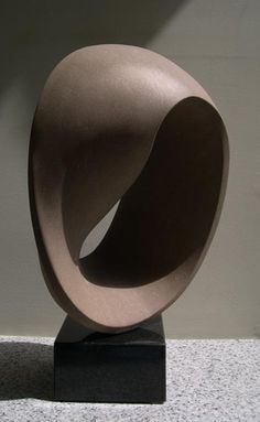 Mobius, 2004, indiana limestone. Michael Binkley abstract stone sculpture.