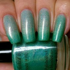 Image of Green with Envy. Jade green thermal reactive nail polish.  Polished by KPT