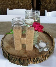 Table wood circle centerpiece with decorated Mason jars, twine wrapped letter   EXACTLY what I wanna make for aj's party!!