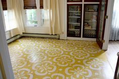 mustard painted wood floor with flower stencil. I love the finished look