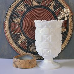 This lovely, white, flared milk glass vase was produced by the Westmoreland Glass Co. of Grapeville, Pennsylvania. 1920s-30s. USA. This beautiful piece features the company's prolific Old Quilt patter