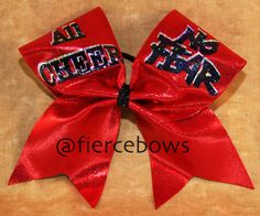 4673 All Cheer, No FEAR is who we are. Bright and shiny red mystic with silver and black holographic lettering make up this fun bow. Cam be made on