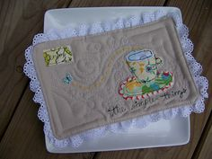 what a fantastic mug rug!  love the quilting