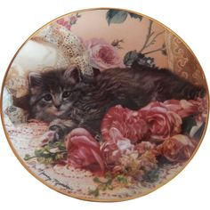 Bed Of Roses 8 1/4 porcelain kitten plate by artist Nancy Matthews. The plate is one of the Franklin Mint's Heirloom Recommendation plates with a