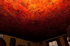 look up at the celing in the Eagle pub.  During World War II, U.S. and British airmen would leave notes on it using lighters, candles, and lipstick.