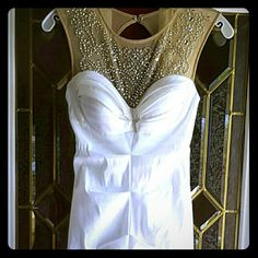 Prom dress Gorgeous mermaid style white prom dress, beautiful silver beading on neckline, very fitted. Dress only worn once. David's Bridal Dresses Prom