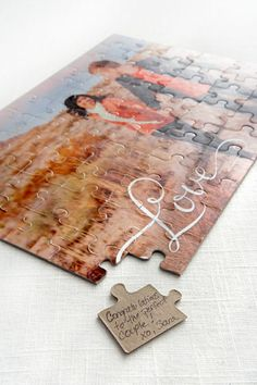 *This is def the guest book* A unique DIY for your wedding guest book. Create a photo puzzle using your favorite engagement photo. Set out the puzzle with pens for guests to sign. You'll have a keepsake that will be pulled out for years to come.
