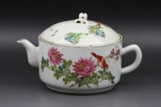 "Antique Chinese Famille Rose Porcelain Teapot: of round form, with design of bird perched on large blooming peony branches around the body and cover, with calligraphy poem, with peach-shaped finial, with four character reign mark in iron-red ""Tongzhi"" sign on the base"