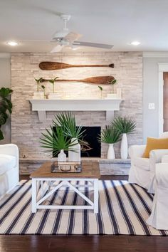 5 Coastal Bedrooms That Will Get You Ready for Vacation | HGTV's Decorating & Design Blog | HGTV Fireplace Stone, Beach Fireplace, Stone Fireplace Makeover, Over Fireplace Decor, White Mantle Fireplace, Beach Mantle, Summer Mantle Decor, Fireplace Feature Wall, Brick Feature Wall