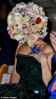 Flamboyant: Gaga turned out to support her pal showcase his spring/summer 2013 collection