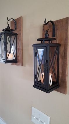Set of two (2) MEDIUM wooden wall-mounted sconces with metal hooks and lanterns. The wooden sconce is made from 100% reclaimed wood. www.idlights.com