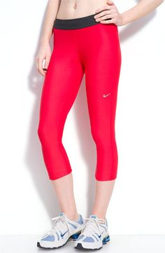 Technical Dri-FIT capris are designed for a chafe-free, non-binding compression fit that helps muscles warm up and recover quicker. Color(s): action red / anthracite. Brand: Nike. Style Name: Nike 'Relay' Capris. Style Number: 383496.
