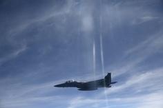 F-15C Fighter... (Victor J. Blue)