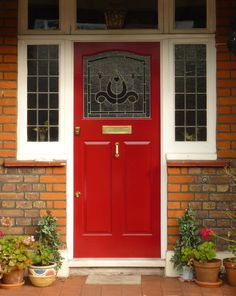 A charming front door with feature side lights and fanlights. Enhanced by a bright red finish and classic brass door furniture. A charming front door with feature side lights and fanlights. Enhanced by a bright red finish and classic brass door furniture. Bright Front Doors, Best Front Door Colors, Unique Front Doors, Grey Front Doors, Exterior Front Doors, Entry Doors, Red Doors, Porch Uk, Front Door Porch