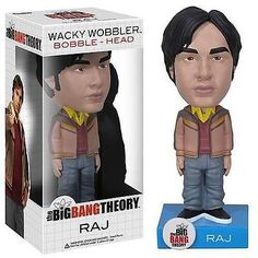"""Your Big Bang Theory bobble head collection cannot be complete without the acclaimed Astrophysicist Rajesh Ramayan """"Raj"""". This Caltech Astrophysicist comes to you standing 6"""" tall with his layered yellow-collared shirt, maroon sweater, brown jacket, blue jeans, and black sneakers atop his own name display base."""