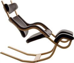 Gravity Reclining Chair by Varier. Its unique construction allows for a variety of support position from leaning forward to a full reclining zero gravity position.