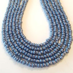 Check out this item in my Etsy shop https://www.etsy.com/listing/545393379/metallic-seed-bead-necklace-seed-bead