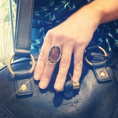 Smoky topaz, diamond and yellow gold ring. Doesn't hurt to pair it with a YSL bag! ;)