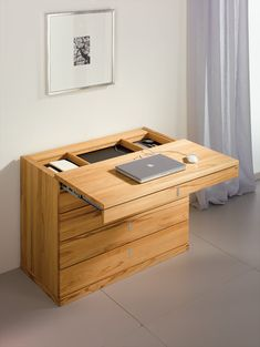 Make the top of the dresser a slide out table and a latch in front to keep it secure when not pulled out