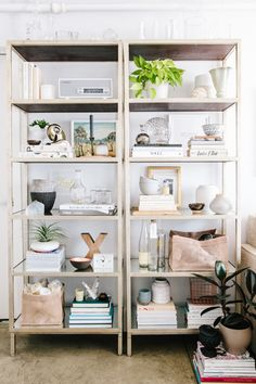 """I didn't have time or budget to change out much of my original office furniture, so I had to be picky. Once I had a work station figured out (thanks to BluDot and their fab Strut Table), I repurposed the rest of my existing pieces. For example, my bookcases now serve to add character and interest to the room, but they're also practical — they house all my styling props."""
