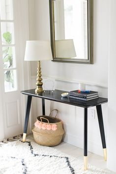 This time-saving hack from Style Me Pretty Living shows us how to transform a basic entry table into a sleek and sophisticated focal point in your home.