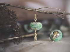 bead crocheted of tiniest glass beads including 24K gold plated beads. Mint ombre pattern by Kvalwasser