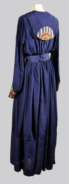 silk dress with dark blue oriental motifs application with a drawstring waist 1910. Paul Poiret