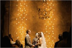 If you've got an indoor venue with a great decorative wall, just a string a few lights and bam! a romantic backdrop. #romantic #weddingbackdrop #vows