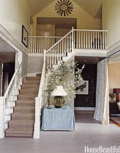 In this entrance hall, designer Jeffrey Bilhuber used a rectangular table skirted in a custom fabric by John Robshaw.