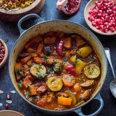 Vegan vegetable tagine filled with aubergine, courgette, carrot, butternut squash and peppers