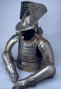Early 17th century half armor, Nuremberg Germany, steel and copper. forged, carved, chased, engraved and gilded.
