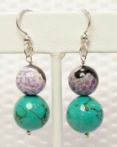 Turquoise and Purple Agate Earrings  *Large polished 12mm turquoise *10mm purple agate *2mm sterling silver *Sterling silver heavy gauge french ear wires *Drop length without ear wires is 1 *Total length with ear wires is 1 3/4  Free USPS first class domestic shipping.  See my entire collection at https://www.etsy.com/shop/kbeadsit