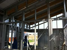 Steel Frame House - Roof sheeting starting to put in place (21/09/12)