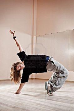 breakdancer standing in bridge. photo in dance studio Stock Photo