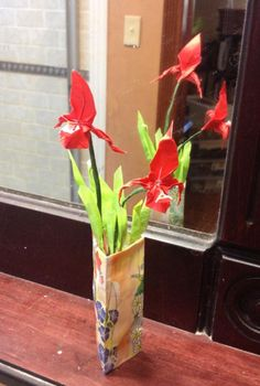Red orchids and vase