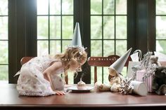 love the birthday photo on table w/ cupcake by Zoe Berkovic