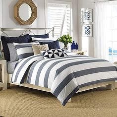 Transform your bedroom into a relaxing retreat with the Nautica Lawndale Reversible Comforter Set. Adorned with a beautiful navy yarn dyed striped design on a pristine white background, the simplistic bedding is a calming addition to any room.