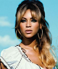 Beyonce with a relaxed half-up, half-down look and full 60's bangs. #beyonce #hair